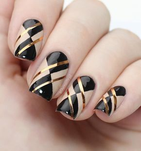 60 Dark Nails for Winter One more combination of warm gold color, and dark cold black color. Combination is very effective and glamorous and you can wear it with every combination of wardrobe.