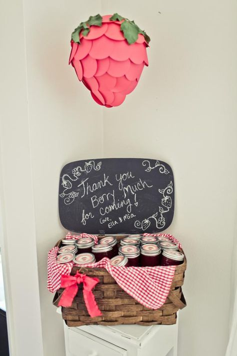 picnic basket filled with homemade strawberry jam for favors - strawberry shortcake party