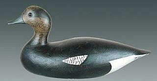 Realized Price:  $85,000 Superlatives pale when attempting to describe the appeal of this widgeon drake by Joseph Whiting Lincoln (1859-1938). This is one of only two widgeon by Lincoln that exist in superb original condition. Few, if any carvers, achieved the pleasing rolling lines and perfect symmetry of a Lincoln decoy. The rich luster and surface texture puts Lincoln above the fray. Few admirers of great decoys would disagree. The paint on this decoy has the same brilliance as on th