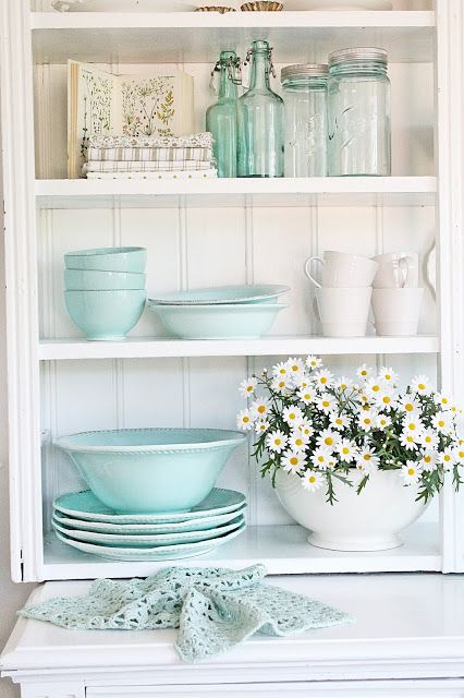 Blue Mason Jars mixing and matching with other blue pieces.  I need to snap a photo of the collectio that has evolved on my book shelf.  Love the daisies on these shelves.  Mine are featuring daylilies.   ~ Mary Wald's Place - VIBEKE DESIGN: In love with AQUA !
