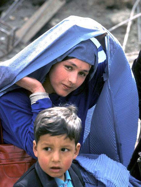An Afghan Woman Lifts Her Veil On We Heart It Afghan Girl Burqa