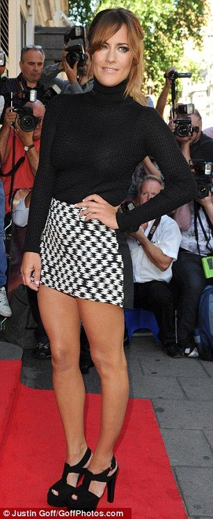 Stunners: Nicole Scherzinger was joined by Xtra Factor presenter Caroline Flack who also stood out in a checked mini-skirt and roll neck