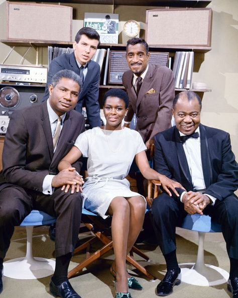 From left to right (back row) Mel Torme and Sammy Davis Jr., (front row) Ossie Davis, Cicely Tyson, and Louis Armstrong, the