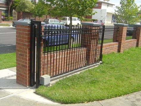 Black Iron Fencing On Top Of A Short Brick Pillar Fence