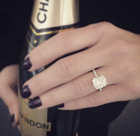 Yes yes yes. The elongated cushion cut, thin pave band, the double prong setting in gold, everything!