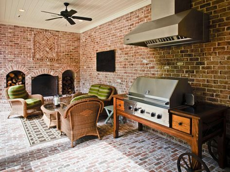 Weather is rarely an issue with this covered patio that features a comfy seating area in wicker and a large gas grill with range hood. This space projects an upscale look, but with its brick walls and floor, it is low maintenance and durable, providing for many months of outdoor enjoyment.