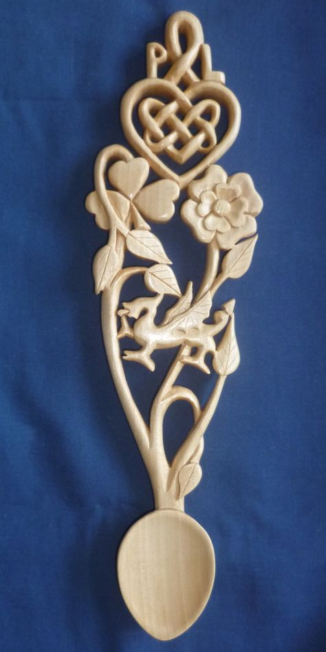 Celtic love spoon with shamrock,rose and daffodil