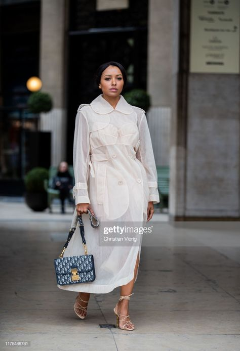 American actress Kat Graham is seen wearing sheer Simone Rocha trench, Dior bag during Paris Fashion Week Womenswear Spring Summer 2020 on September 2019 in Paris, France. Get premium, high resolution news photos at Getty Images