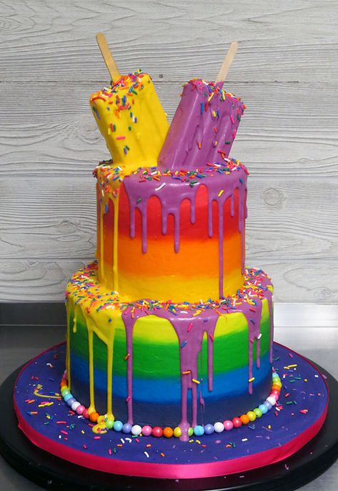 Buttercream cake topped with melting popsicles (they're really cereal treats sculpted to look like popsicles, then dipped and dripped with candy melts, and finished with sprinkles.