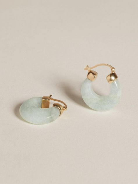 The Glacé collection pairs semi-precious stone with gold, exploring the limits of shape within our signature lens of timelessness and wearability. The resulting collection feels equal parts modern statement and relics that could belong to any era.Aquamarine hoop earrings with solid 14k gold or sterling silver end caps and hinge closure. Sold as pair. Kindly note that aquamarine is a fragile natural stone, and must be handled delicately to avoid breakage. Gold Hoop Earrings, Crystal Earrings, Sterling Silver Earrings, Stud Earrings, Jade Earrings, Cartilage Earrings, Vintage Earrings, Septum, Silver Ring