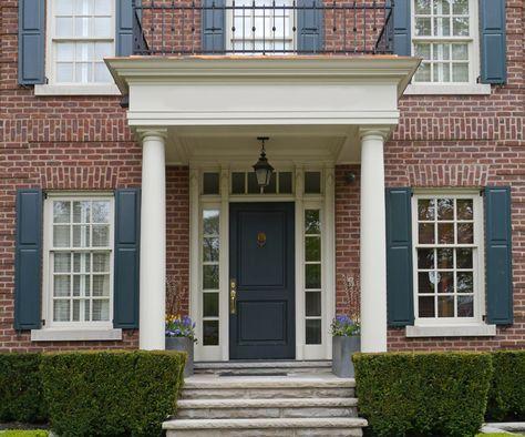 Red brick house dark blue door