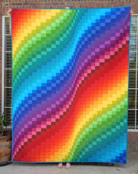 MADE TO ORDER. Current turnaround time is 2 to 3 weeks. Who doesnt love a rainbow! Choose from 5 sizes. Sizes are approximate. lap size - 59 x 71 (pictured with gray binding) twin size - 61 x 85 (pictured with blue binding) full/double - 78 x 85 queen size - 93 x 100 king size - 105 x 100 (pictures with black binding) Its made from high quality 100% cotton fabrics. You may choose the solid color of the back and binding on the bed size quilts. Professionally longarm quilted in a meande...
