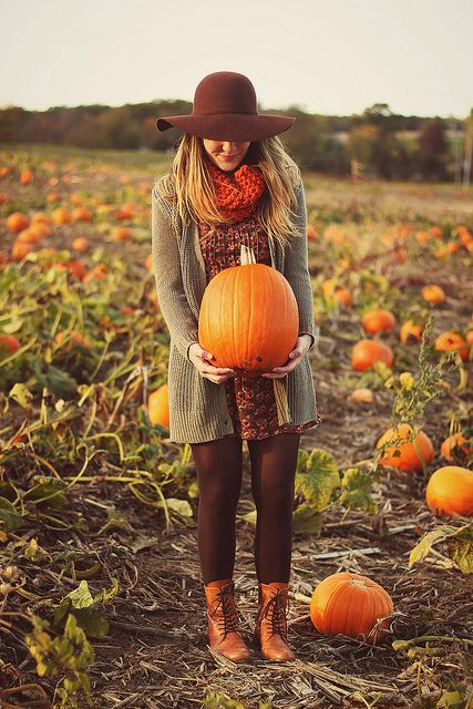 it's probably not, but this would be a cute fall maternity photo. :) the pumpkin in front of her belly! So precious.
