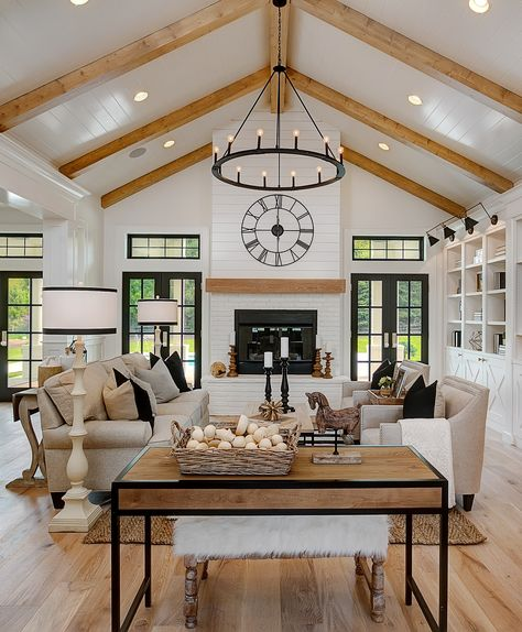 The great room in this Modern Farmhouse home features a custom painted brick and shiplap fireplace with a wood stained mantle that coordinates with the natural wood beams of the vaulted ceiling. Vaulted Living Rooms, Home Living Room, Kitchen Open To Living Room, 60s Kitchen, Kitchen Ideas, Living Room Wood Floor, Dining Room, Cottage Living Rooms, Living Room Designs