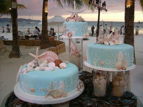 Beach sea theme wedding cakes ME GUSTA QUE HAYA ARENA EN LOS ARREGLOS, No tanto la deco de la torta