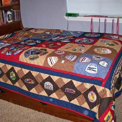 Quilt made from boy scout's collection of over 100 badges. Back is regulation scout material.