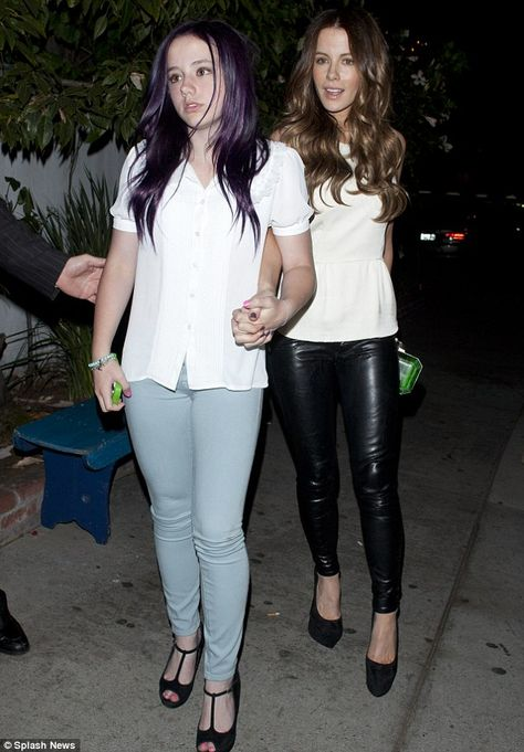 Birthday girl: Kate Beckinsale slipped into a pair of skintight black leather trousers last night to celebrate turning while her daughter Lily debuted her newly-purple hair
