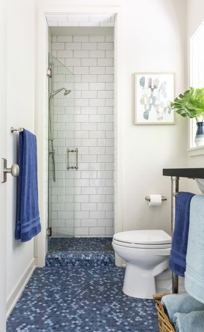 This Houston Home Makes Decorating On A Budget Look Luxe Blue Bathroom Tile Small Bathroom Bathrooms Remodel