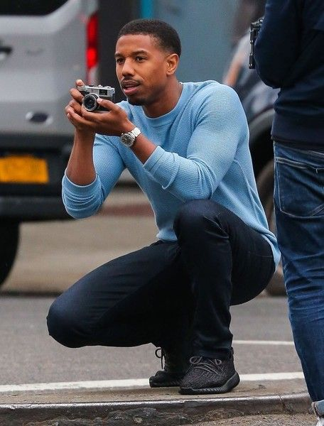 Actor Michael B. Jordan is spotted on the set of a photo shoot in New York City, New York on May 4, 2016. Michael was pretending to take pictures with an old school camera during the shoot.
