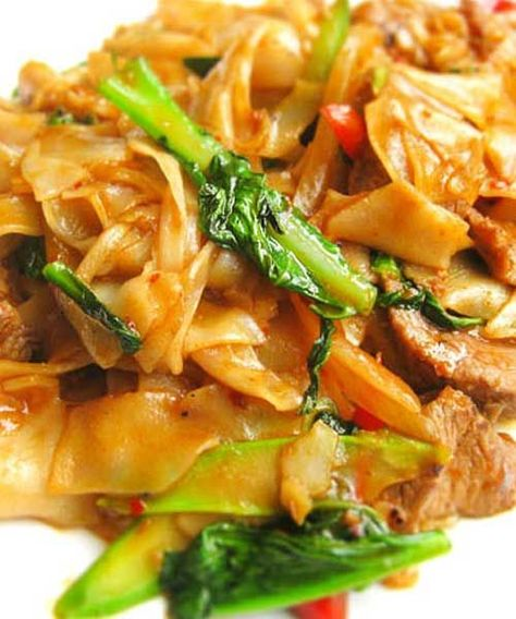 Recipe for Thai Drunken Noodles - There isn't a drop of alcohol in this dish — the name refers to how much you'll want to drink to combat the heat. We suggest a nice cold beer or sparkling wine.