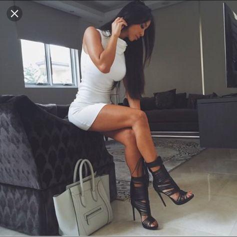 Yarishna Ayala - White turtle neck dress, killer heels, name brand purse
