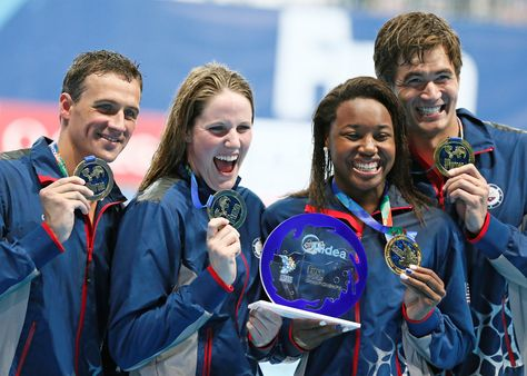 The Day in Sports Photos... The relay team of the U.S., Ryan Lochte, Missy Franklin, Simone Manuel and Nathan Adrian (L-R) pose with their gold medals after winning the mixed 4x100m freestyle relay final at the Aquatics World Championships in Kazan, Russia, on Saturday. This is the first time there have been contested in the world championships.