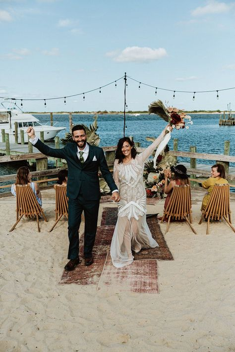 Jersey Shore weddings are some of my absolute favorite weddings! It's the official vacation spot for New Jersey residents, so what better place to tie the knot? In this blog is a list of some gorgeous New Jersey Beach wedding venues and some stunning wedding photos from my Brides who chose to get married down the shore! Photo: Sara Fitz Co. #njwedding #jerseyshorewedding #njbride #newjerseywedding