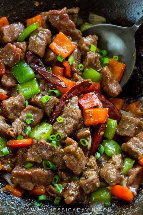 Mongolian beef is tender pieces of stir-fried marinated flank steak tossed with bell peppers, dried chilis, and a savory Asian-style sauce. #mongolianbeef #chinese #stirfry #asiancuisine #takeout