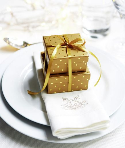 Make place cards out of small boxes of chocolates to complement after dinner coffee at a dinner party.