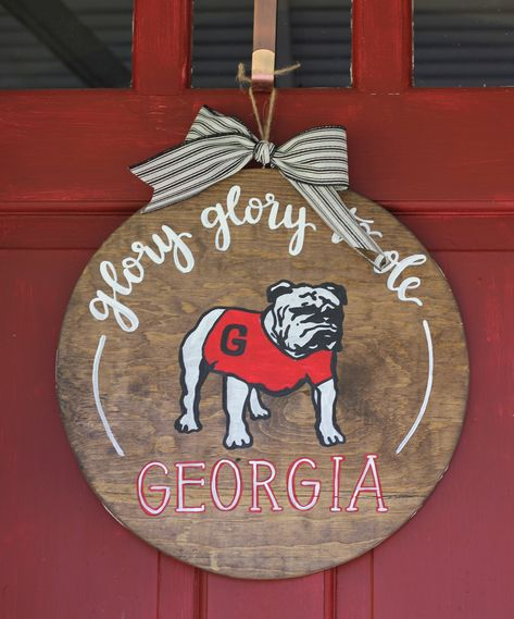 Hand painted Vintage Georgia Bulldog Football Door Hanger www.thechelseacol… Hand painted Vintage Georgia Bulldog Football Door Hanger www. Georgia Bulldog Wreath, Georgia Bulldog Mascot, Georgia Bulldogs Football, Football Crafts, Football Wreath, Football Door Hangers, Wooden Door Signs, Florida Gators, Manualidades