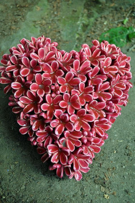 Heart shaped with tiny pink flowers.
