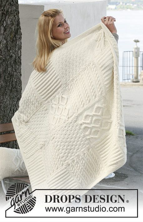 """Warm Hug / DROPS 124-3 - Knitted DROPS blanket with squares in different structured patterns in """"Nepal""""."""