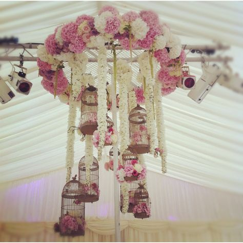 white an pink floral chandelier, hydrangeas, vintage birdcages