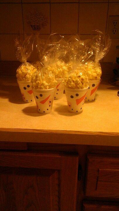 Snowman popcorn treats - stirofoam cups. Marker. (Red thump print cheeks) Construction paper. Baggies of popcorn