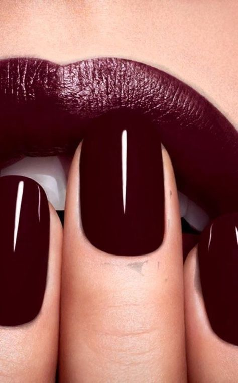 Burgundy nail polish and lips stick