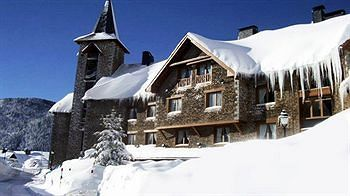 Cozy up to the fire apres ski at this charming chalet in the Pyrenees