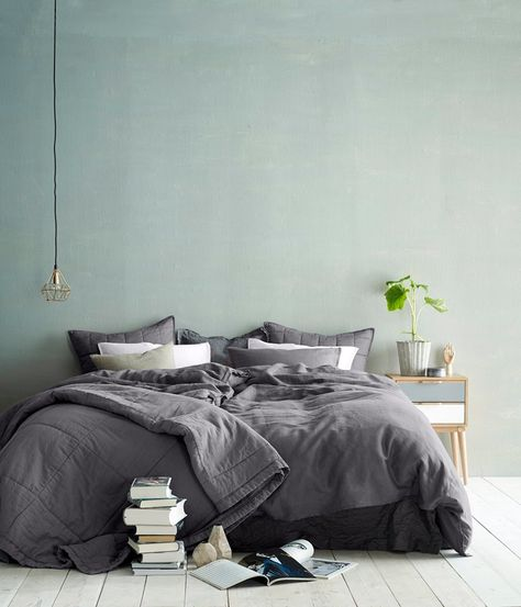 hes got a simple, slightly dishevelled room, simple dull colours and the occasional plant