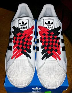 White Adidas Superstar IIs with black trim and red & black Angled ...