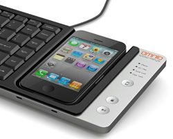 USB keyboard with Iphone dock features 'PC mode', in which an iPhone can be used as a multitouch interface for macs and PCs; and 'iPhone mode', which allows text entry from the keyboard directly into the smartphone.