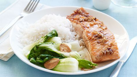 """Al Roker's Grilled Ginger Salmon with Maple-Ginger Glaze: """"When it comes to cooking, I'm pretty much a traditionalist. I've been making this dish for at least 10 years. Salmon's a flavorful fish, and it stands up well to other flavors. So if you put a little maple on it, plus salt and pepper, you get a sweet and savory dish. And it's family-friendly—kids like it. Sometimes, my children help me cook—even if it's just stirring something or putting a dish in the oven. But if a recipe requires a lot of chopping, or if I really have to get stuff done in a certain amount of time, then I let them do other chores, like setting the table. """""""