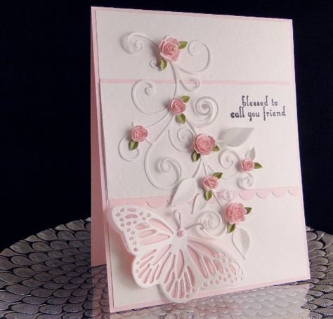 Butterfly and Pink Roses  Impression Obsession Butterfly, Roses and sentiment  Die-namic Flourishes  Punch Bunch small leaf punch  Unknown Textured white paper (wish I had more of it)  Michaels pink card stock  Half pearl