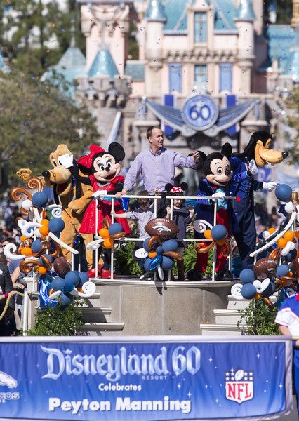 In this handout photo provided by Disney Parks, In honor of the Denver Broncos' victory at Super Bowl 50, the Disneyland Resort saluted quarterback Peyton Manning with a champions parade down Main Street, U.S.A. at Disneyland Park in Anaheim, Calif., on Monday February 8, 2016. Some favorite Disney characters joined the parade as Manning rode in a float with his children, Mosely and Marshall.