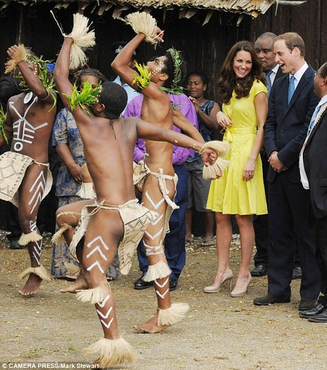 It's a bit like Morris dancing... The Duke shares a joke with his wife as they watch locals in Honiara perform during their visit