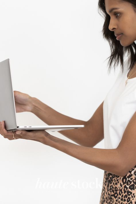 Neutral creative processes styled stock photography for designers featuring stylish woman holding laptop.  #hautestock #workspace #stockphotography #styledstockphotography #femaleentrepreneur #blogger #socialmedia #graphicdesign #designer #neutral #interiordesign #creative