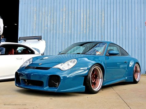 I must admit, I've always liked this style of aftermarket facia on the Porsche 996. This one we saw at First Class Fitment was nice and clean. -Nick