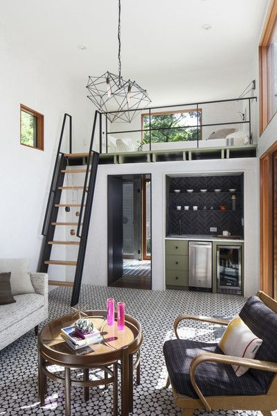 The new casita features a double-height living room with custom cement tiles and plaster walls, as well as a kitchenette nook, and custom steel