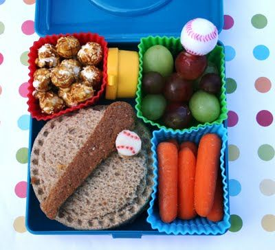 Salami and cheese or PBJ on whole wheat sandwich with provolone baseball decorated with food safe markers.   Carrots with ranch   Red and green grapes with a baseball pick