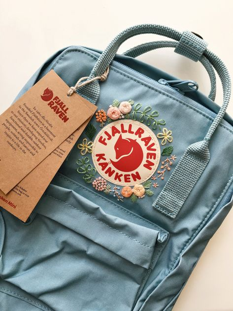 Fjallraven Kanken Embroidery Bag Customizable Fjallraven Kanken Hand Embroidery Backpack You can choose your favorite color from the Fjallraven Kanken website! *Mini Sky Blue - Mini Air Blue - Classic Pink is out of stock for a while.