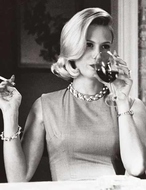 Betty Draper from Mad Men is the epitome of the perfect 50's housewife. Plus the hair and material of the dress would fit into Brothers costuming.