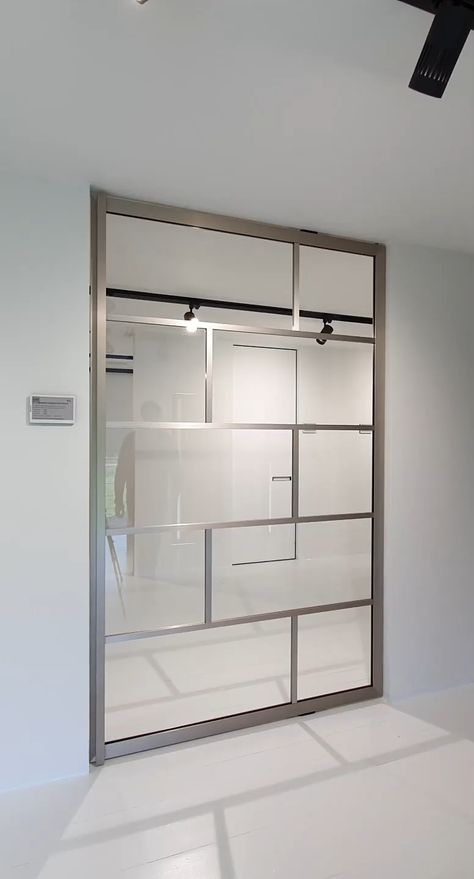 Glass pivot door stainless steel #deptodublin Glass pivot door finished in a very special stainless steel anodized aluminium. The pivot hinge is fully intergrated inside the door! There's nothing that needs to be installed in advance.  Find local resellers on www.portapivot.com